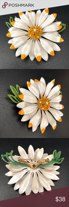 """Retro Enamel Daisy Flower Brooch Awesome vintage! This cheerful vintage brooch is enameled in white and some of the petals have hand-painted golden yellow tips. The center bloom features tiny golden yellow enameled flowers with white centers while a green leaf provides additional visual interest. Measures 2-1/2"""". In excellent preowned vintage condition. Smoke-free home. Vintage Jewelry Brooches"""