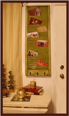i LOVE this as a christmas card holder! easy! spray paint a window shutter.