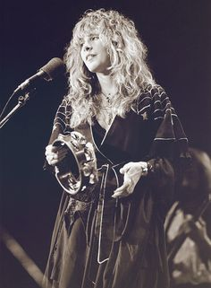 a lovely black and white photo of Stevie with beautiful tousled hair onstage, wearing her famous spider web cape, 1977  ~    ☆♥❤♥☆    ~       http://www.gettyimages.com.au/detail/news-photo/photo-of-stevie-nicks-and-fleetwood-mac-stevie-nicks-news-photo/86122848