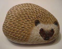 Hedgehog hand painted on a rock.