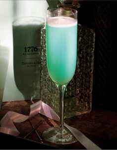 tiffany & co. (Craft Cocktails author Brian Van Flandern created this beautiful Tiffany blue concoction in 2007 to coincide with the launch of the company's cocktail rings. Made with pear vodka, Moscato D'Asti, Alizé Bleu and lime) Refreshing Drinks, Fun Drinks, Yummy Drinks, Alcoholic Drinks, Beverages, Craft Cocktails, Cocktail Drinks, Pear Drinks, Pear Vodka