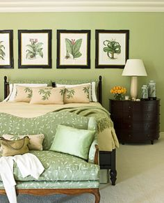Monochromatic bedroom with botanical artwork.