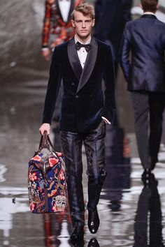 Serving up unparalleled luxury @ Vuitton Fall 2013 - The tuxedo + the Chapman brothers printed tote = Love, love, love.