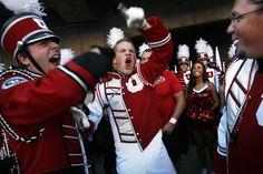 (Scott Sommerdorf   |  The Salt Lake Tribune)  Utah drum major Cheston newhall gets the band fired up before gametime..