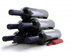 Smart Wine Bottle Storage  Space saving Stack up to 6 bottles Great in fridge too!  Use stack to display your bottles in a unique and space saving way. Either in a pyramid of up to 6 bottles. The choice is yours. Made of high quality silicone rubber.