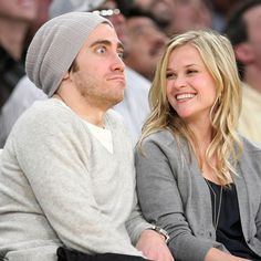 Pin for Later: Reese Witherspoon's Smile Will Put a Grin on Your Face, Too  Reese gazed at then-boyfriend Jake Gyllenhaal during a Lakers game in January 2009.