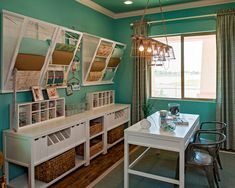 Now this is a very cool craft/hobby room! Check out the cool light fixture...love the color palette in this room to tie in the gorgeous wood floors! Awesome!