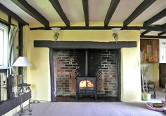 Stovax Stockton 8 wood burning stove fitted into a thatched cottage with old Essex inglenook in Willingale by Scarlett @ Design a fireplace 2006