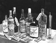 Bootleg liquor, seized in a Prohibition raid and labeled with their poisonous contents by Los Angeles Police Chemists - 1928