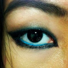 Strong and smokey.  azncateyz:    Smokey Eye with turquoise liner for monolids