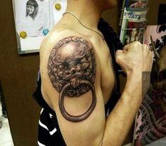43 lion tattoo as a door knocker
