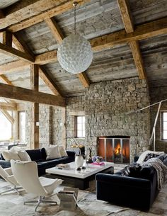 Amazing-Rustic-Style-Living-Room-with-Jagged-Stonw-Wal-with-Fireplace-and-Wooden-Ceiling-with-Exposed-Beams-Furnished-with-Modern-Black-and-Whitre-Furniture.jpg 600×776 pixels