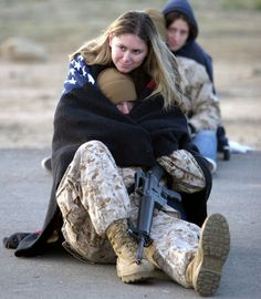 Families say their goodbyes before the Marines leave for a year in Iraq in support of operation Iraqi Freedom. Many families spent the night in the staging area with their Marines the whole night where the temperature reached 38 degrees
