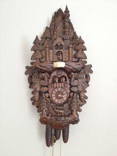 Beautifully handcarved Castle Cuckoo Clock made in the Blackforest region of Germany. Photo via Ebay