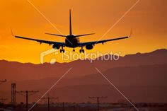 Orange airliner landing