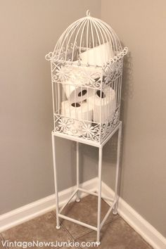 Love the idea as a birdcage for a Toilet Paper Holder in the powder room.