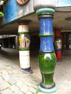 Columns under terrace of Hundertwasser house