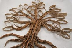 Tutorials: Paper Roll Twisted Oak Tree sculptural wall art.  Easy for kids to make too