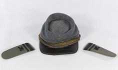 Lot 520: Indian Wars Kepi Cap; Child size cap from the 1880s era; together with a pair of 1950s shoulder board epaulets