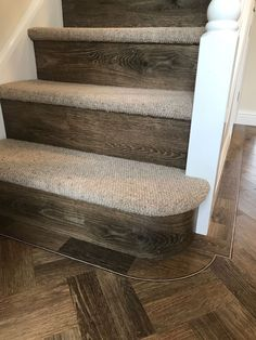 Amtico Spacia Noble Oak Parquet fitted to a Hall with a Tram Line Border. The planks were laid as a double Parquet plank with a full width plank fitted on the risers