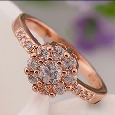 today sale only!!! $15!! Rose gold plated size 7 statement wedding engagement ring   Style ?Solitaire Main Color?Clear Metal?Rose Gold Plated Metal Purity?18k Main Stone:Zircon Weight:3.20g Ring Size?7  Box included :) Jewelry Rings