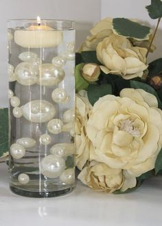 """Easy Elegance - 34 Jumbo Ivory and White Pearl Beads - the Clear Jelly Beadz Water Gels """"floating"""" the Pearls are FREE. by shenzen. $8.95. The mix of the four different sizes is unique as a vase filler for table accent centerpieces with or without candles or flowers. If you are interested in only the Ivory color or any other colors please contact us through Amazon.. Easy to follow intructions included. The Elegant Oversized Pearl Beads are the hottest trend. Great ..."""