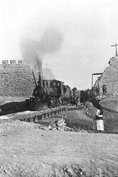 Chinese Photographer, First train passing through the wall of Peking, China, c.1900