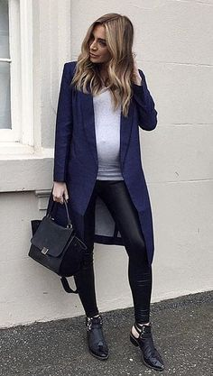 A sophisticated coat, liquid leggings, and black booties
