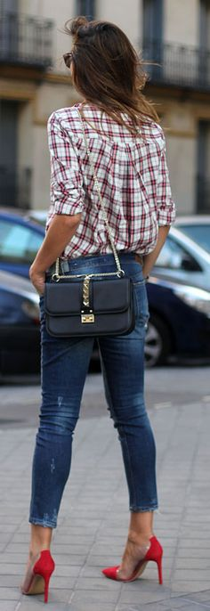 Silvia Zamora is wearing a plaid shirt and jeans from Zara, shoes from Krack and a handbag from Valentino