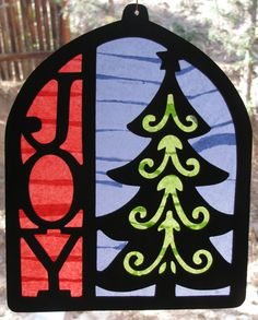"""Tissue paper """"stained glass"""" - you can use black construction paper instead of wood"""
