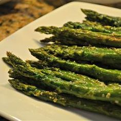 Oven-Roasted Asparagus Recipe |  Put asparagus on flat tray, added some oil.  Added salt and pepper.  Baked.  That was it, didn't bother with the rest.  He loved it.