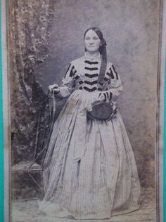 CDV, 1860's, dress with velvet trims, ribbon in hair, hat in hand with nice trimmings.