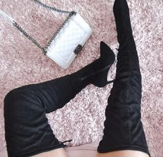 Thigh-high boots take any outfit to new heights.