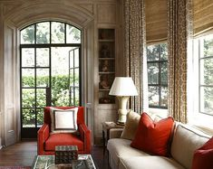 love the impact created by pops of red in this otherwise monochromatic room...