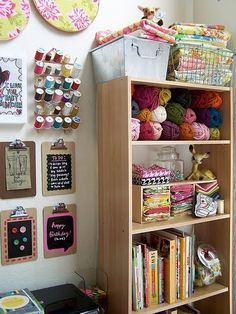 Hmmmm the sewing and knitting stuff in plain view - love all the colors why put it in a drawer. Much more inspiring to see it.