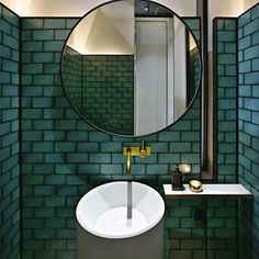 A dark grout really makes the emerald green tiles standout