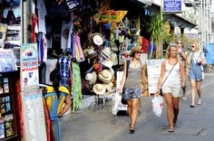A bargain-hunter's dream: colourful market stalls on Poppies I in Kuta, Bali. Image by Tom Cockrem /... - Provided by Lonely Planet