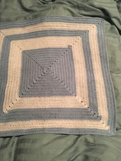 Blue and white crocheted blankie