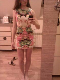 http://www.aliexpress.com/item/Quality-Fashion-Casual-Summer-2014-New-Sleeveless-O-neck-Floral-Print-Womens-Short-Straight-Dress-Sale/1597149336.html