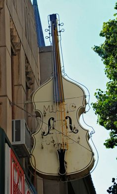 Cello on the balcony (Violoncelo na sacada) Storefront Signs, Vintage Neon Signs, Pub Signs, Roadside Attractions, Shop Fronts, Advertising Signs, Store Signs, Hanging Signs, Neon Lighting