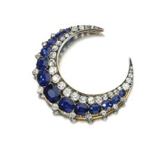 Sapphire and diamond brooch, 1890s Estimate: 5,000 - 7,000 GBP Designed as a crescent moon, set with a graduated line of cushion-shaped and circular-cut sapphires accented with a line of circular-cut and rose diamonds, detachable brooch pin.   Similar on my Bouquet