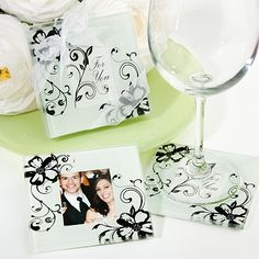 """Our Elegant Floral Photo Coaster Wedding Favors are fun and festive, and perfect for your spring or garden theme wedding! Each set of 2 frosted white coasters is adorned with a beautiful floral design, inspired by wild flowers in full bloom. The photo window can accommodate a 2"""" x 1.5"""" photo or place card, making this a pretty and practical wedding favor! Your guests will enjoy these lovely coaster wedding favors for years to come!Size: Each coaster measures 3.5"""" squareDetails: Each set of 2…"""