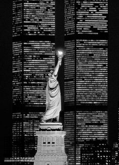 The Statue of Liberty, flanked by the twin towers of the World Trade Center, 1983.