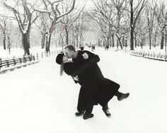 Winter kiss - great idea for engagement photos. Would also be fun in the fall.