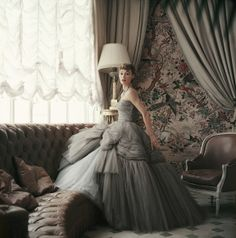 An extravagant Christian Dior ballgown photographed in the designer's very own apartment in Paris. Photographer: Mark Shaw.