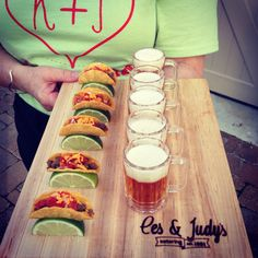 Ces & Judy's Catering loves unique tray passed hors D'oeuvres like these mini tacos paired with mini beers!