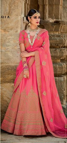 Price @12599.00 INR Colour : Pink Top Material : Mastani Silk Lehenga Material : Art Silk Dupatta Material : Net Work : Heavy Embroidery With Handwork