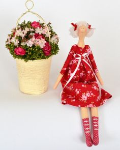 Charming little tilda doll. Its height just 13 inches, and sitting 6 in.  Red dress with roses made ​​of tilda cotton, hair of wool yarn and are