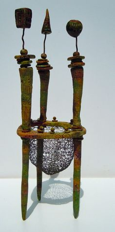 Gera Scott-Chandler; polymer clay and wire ... ok, so it's not actually rusted metal but still oh-so-cool.