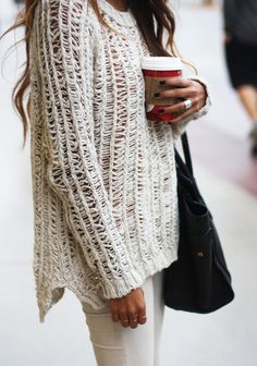 That's definitely my twin, wearing my chunky sweater, cream coloured pants, and holding a warm Starbucks close to her heart